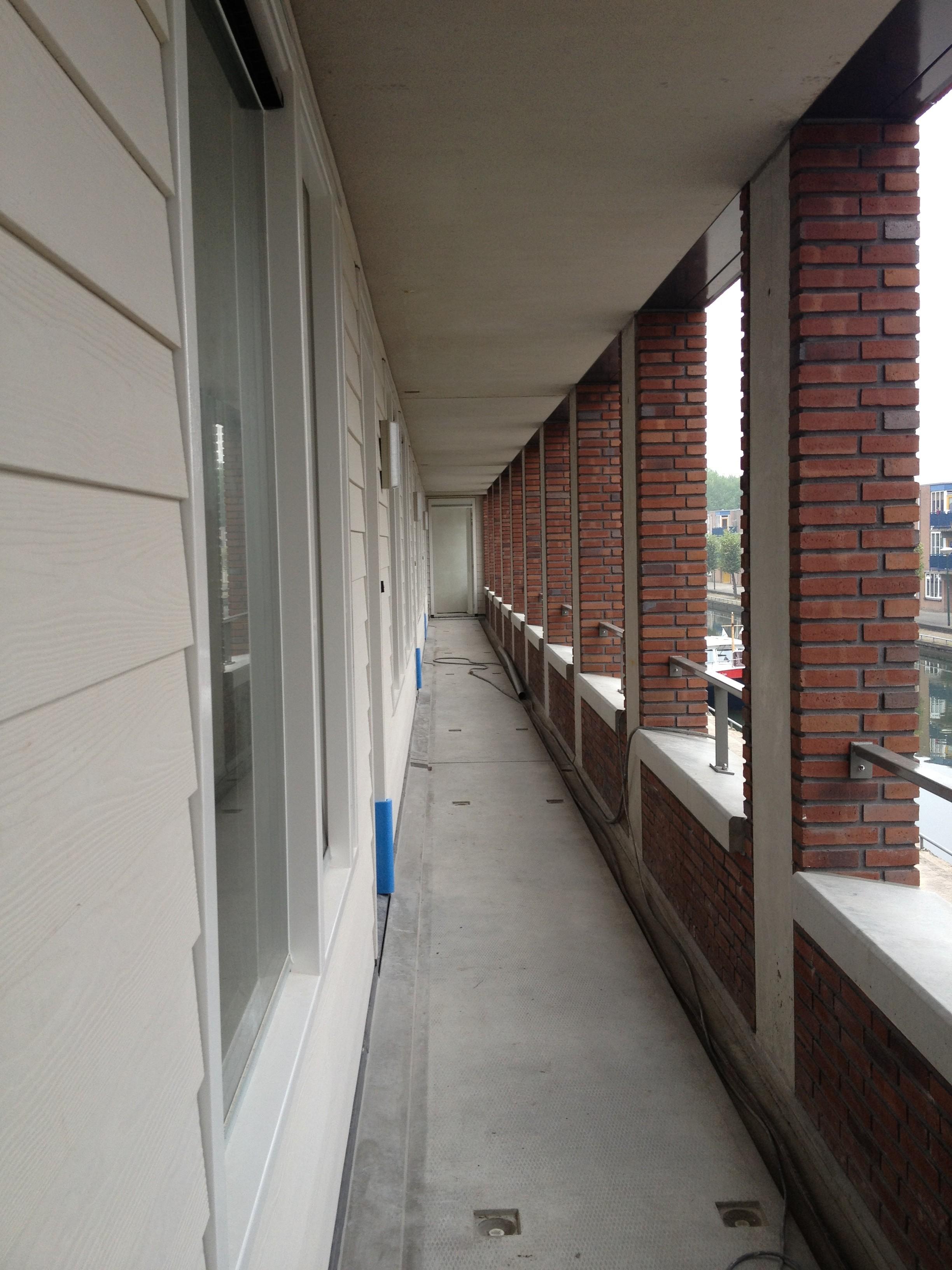 BKT_provides_devriesenverburg_IJsselstein_appartementen_Panoven_parkeerkelder_schuindak_metslwerk_zink_bouwbord_Cubord_Esbi_04.jpg