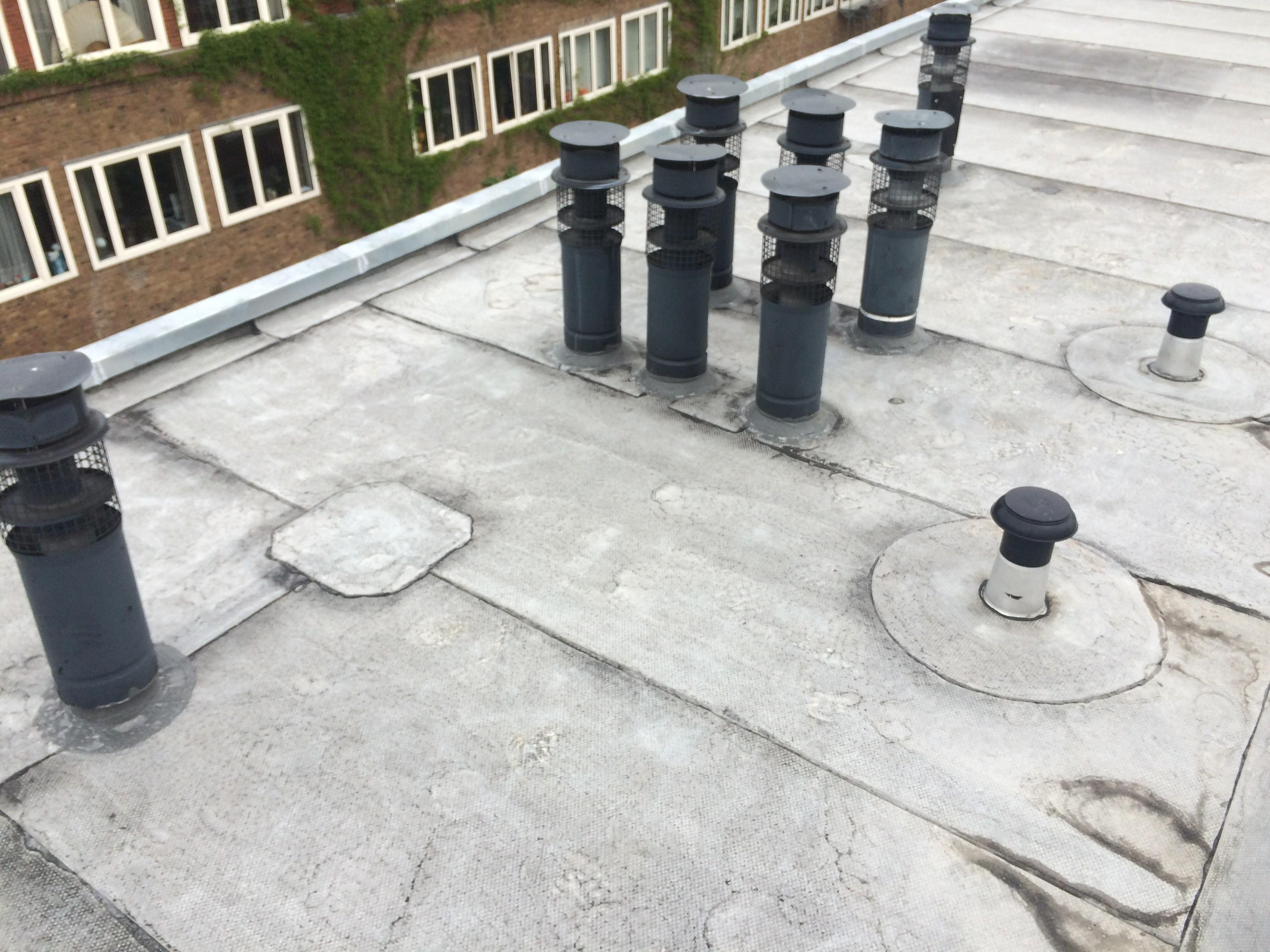BKT_Ymere_dak_onderhoud_zinken_randstroken_Amsterdam_schoorstenen_02.jpg